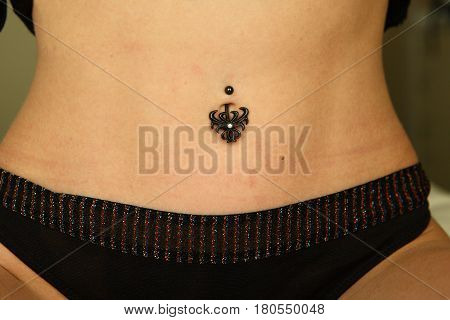close up of a sexy woman wearing bellybutton piercing