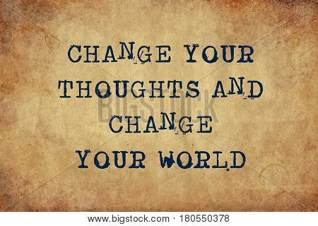 Inspiring motivation quote with typewriter text change your thoughts and change your world. Distressed Old Paper with Typing image.