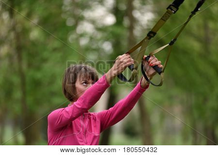 Woman Doing Arms Biceps Curl Training With Trx Fitness Straps