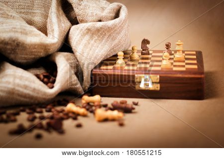 Chessboard and coffee beans. Selective focus on the knight
