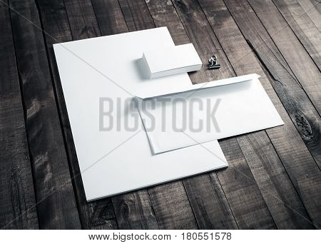 Photo of blank letterhead business cards and envelope. Blank stationery set on wooden table background. Mock up for branding identity. ID template. Blank corporate identity.