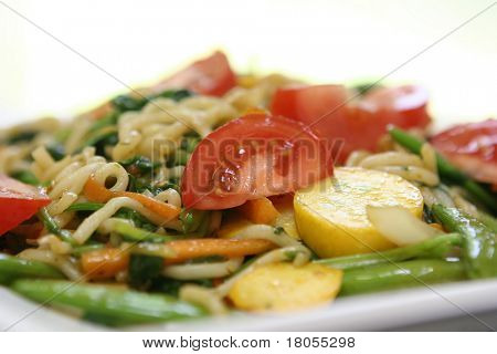 Close up of a plate of vegetarian noodles on white plate