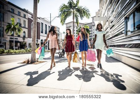 Women making shopping in Beverly hills and having fun