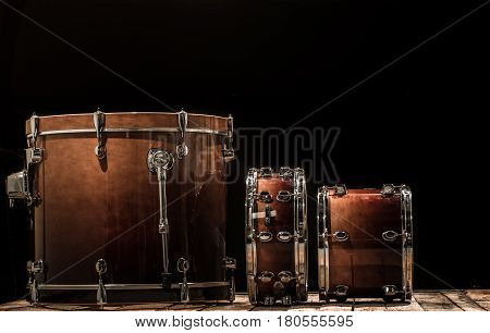 drums, musical percussion instruments on a black background, the music concept
