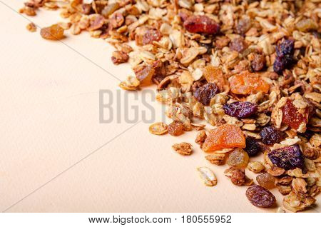 Homemade granola with honey, oatmeal, nuts, raisin, cranberry and dried apricots for background, horizontal