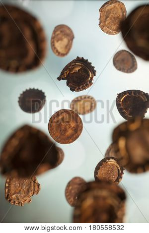 Old rusty bottle caps falling like rain