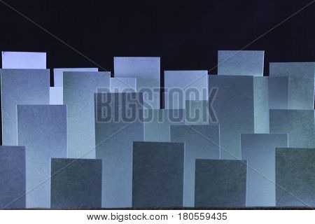 Macro composition of sticky blue paper flags on a black background