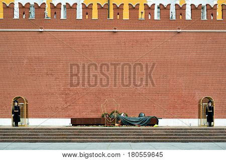 MOSCOW - APRIL 28, 2016: Tomb of the Unknown Soldier at the Kremlin Wall. The Eternal Flame burns in memory of the millions of Soviet soldiers who fell in the struggle against Nazism.