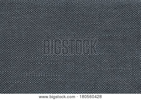 Dark blue background with checkered pattern closeup. Structure of the fabric with checkerboard pattern macro.