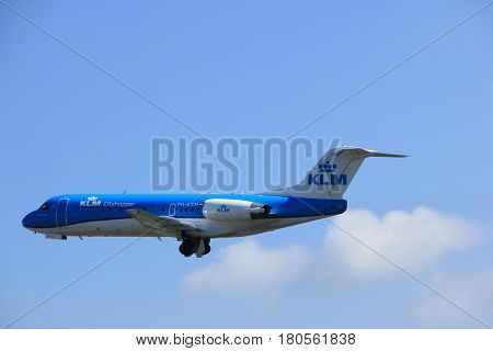 Amsterdam the Netherlands - April 2nd 2017: PH-KZM KLM Cityhopper Fokker F70 takeoff from Polderbaan runway Amsterdam Airport Schiphol