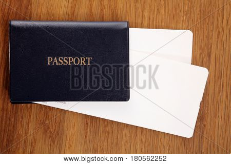 boarding pass and the passport on the wooden table