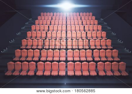 Front view of bright red cinema seats on dark background with spotlight. Movie concept. 3D Rendering