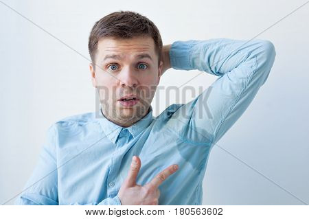 Caucasian, Young Man Is Worried And Shows Sweating Stain Problem With Sweating - Hyperhidrosis