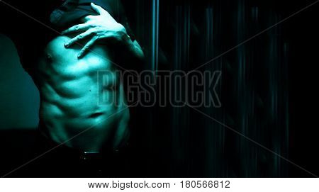 Nude sporty slim attractive muscular fit male model man naked with strong six pack abs obliques muscles chest and arms.