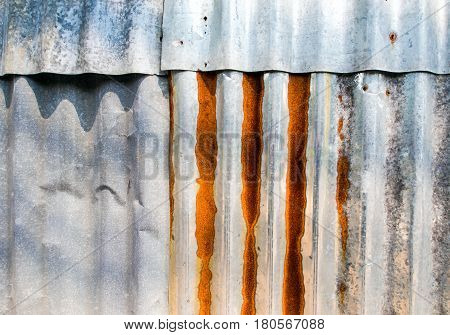 Rusty corrugated galvanized sheet iron fence of construction site