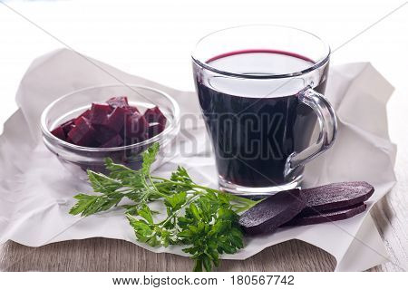 Beet juice in glass and pieces of sliced beets