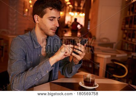 Charming Millenial Texting In A Restaurant