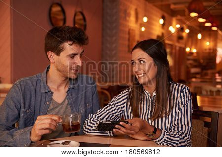 Happy Millenial Couple Looking At Each Other