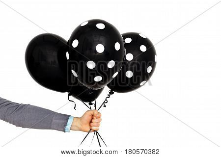 Caucasian Man Holds In Hand Black Balloons. Present For Sad Event