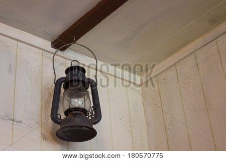 Old gaz lamp in marine style hooked to wall