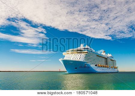 Port Adelaide South Australia February 14 2017: MS Ovation of the Seas cruise ship leaving Outer Harbour at sunset.