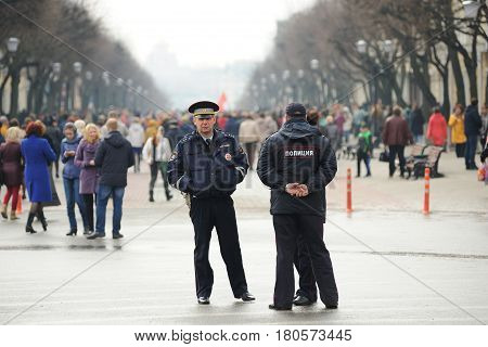 Orel Russia - April 08 2017: Meeting against terrorism. Policemen standing near crowd of people horizontal