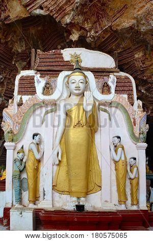 Ancient Buddha statue inside sacred Kaw Gun Cave in Kayin State Hpa An Myanmar.