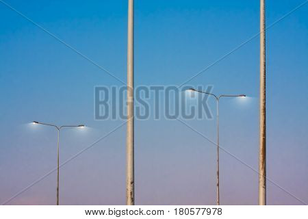 pole streetlight in evening with beautiful blue and pink sky