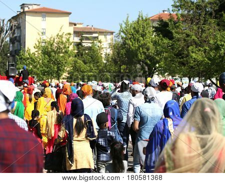 Vicenza, Vi, Italy - April 8, 2017: People Sikh Procession Pray During A Religious Nagar Kirtan Fest