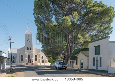 PHILIPPOLIS SOUTH AFRICA - MARCH 21 2017: A street scene with the Dutch Reformed Church and historic buildings in Philippolis the oldest town in the Free State Province