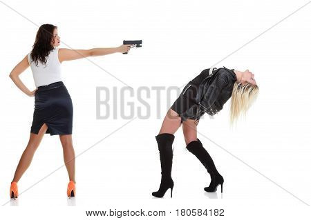 Woman with pistol pointing on her head isolated on white