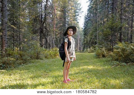 The girl is traveling in the Altai taiga Russia