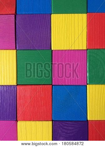 Colorful wooden cubes background. High angle view.