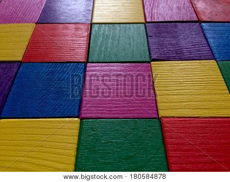 Colorful wooden cubes background. Perspective angle view.