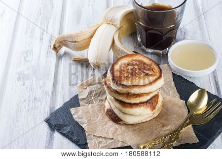 Stack Of  Pancakes In A Dish On Wooden White  Background