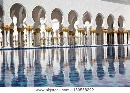 ABU DHABI UAE - March 18 2017: Sheikh Zayed Grand Mosque in Abu Dhabi United Arab Emirates. It iis the largest mosque in United Arab Emirates for more than 40000 prayers.