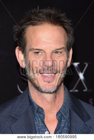 LOS ANGELES - MAR 28:  Peter Berg arrives for the CinemaCon 2017-STX Films
