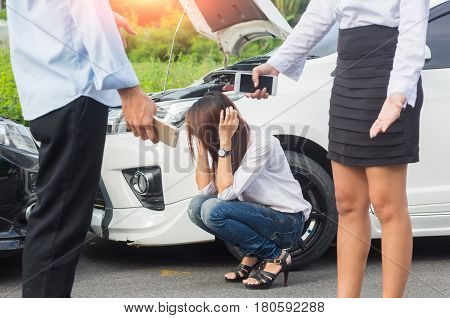 Asia woman a driver in front of automobile crash car collision accident in city road.