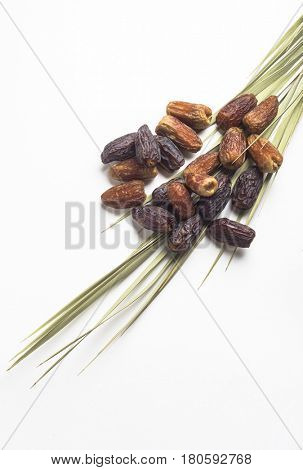 Plenty dates placed on a palm leaf. An isolated image.