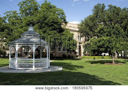 County courthouse with a white gazebo in foreground.