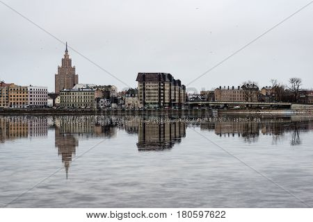 city light reflections over water at the colorful panorama of Riga Latvia