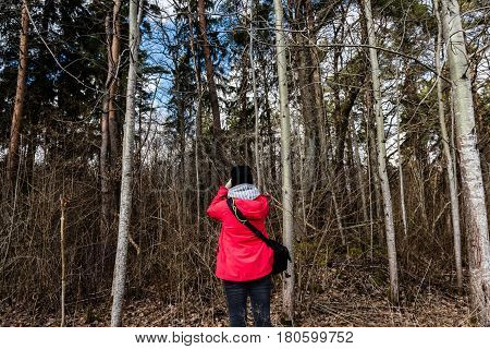 Young Woman In Red Dress Enjoying Nature With Photo Camera