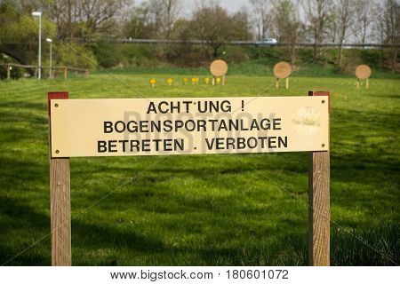 Sign in german at archery range prohibitting entrance to unauthorized personnel