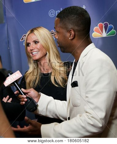 NEW YORK-AUG 12: Model Heidi Klum (L) and AJ Calloway attend the 'America's Got Talent' Season 10 Results Show at Radio City Music Hall on August 12, 2015 in New York City.