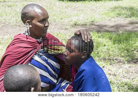 Woman Painting Girls, Maasi Village, Ngorongoro Conservationa Area, Tanzania