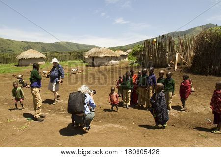 Tourists In Maasi Village, Ngorongoro Conservationa Area, Tanzania