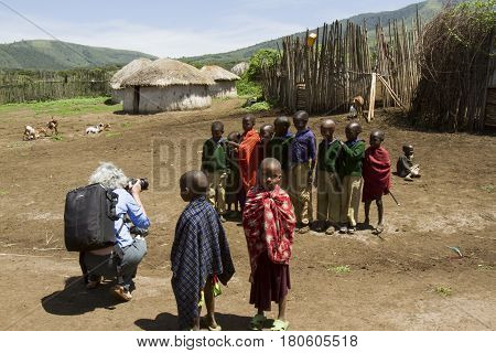 Tourist In Maasi Village, Ngorongoro Conservationa Area, Tanzania