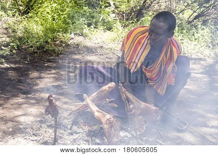 Maasi Male Cooking Ceremonial Meal, Ngorongoro Conservationa Area, Tanzania
