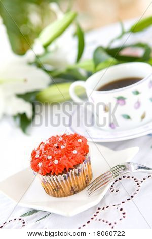 Pretty cupcake served with coffee