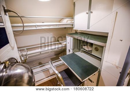 HONOLULU, OAHU, HAWAII, USA - AUGUST 21, 2016: triple room for crew with lockers, cots and desk of USS Bowfin Submarine SS-287 at Pearl Harbor. Popular tourist attraction in Oahu, Hawaii.
